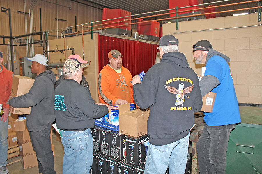 Image of plumbers helping with the water crisis in flint.